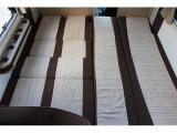 ダイネットをベッド展開すれば大人3名様がゆったりと横になれるスペースに!